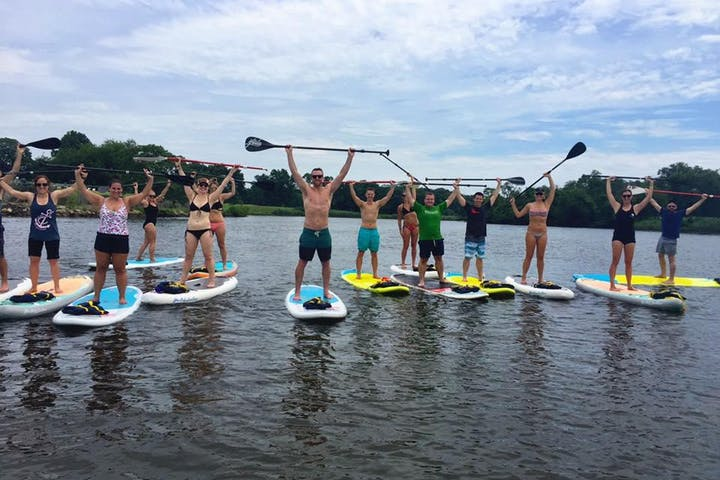 Group of people on a stand up paddle board event