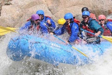 group rafting down rapids