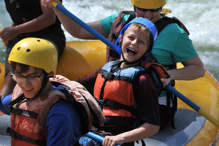 child smiling and rafting