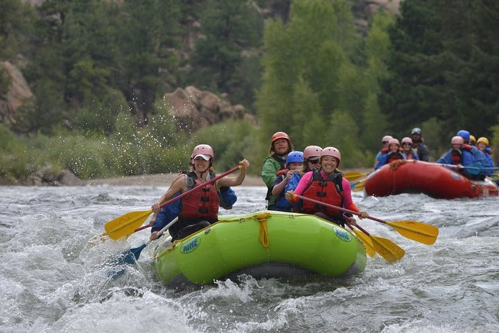 group rafting down a river