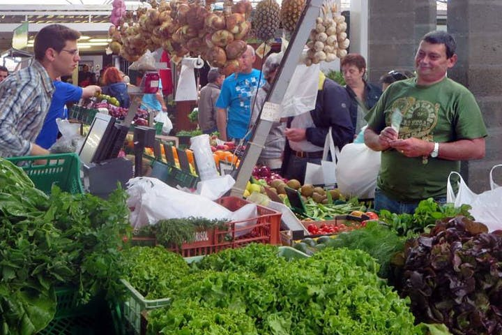 people buying food at market
