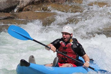 a person riding on a raft in a body of water