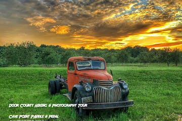 Photo of old pickup truck in a field from the Door County Hiking and Photography Tour