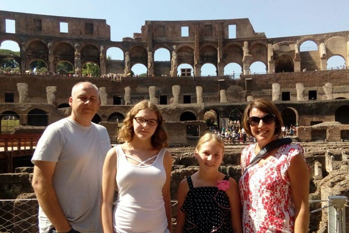 Family enjoying a tour in the Colosseum Rome