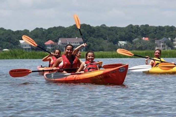 Group of people kayaking in the water