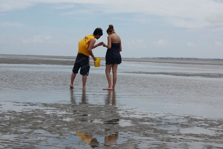2 people interacting on the beach