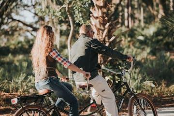 2 people on a tandem bike