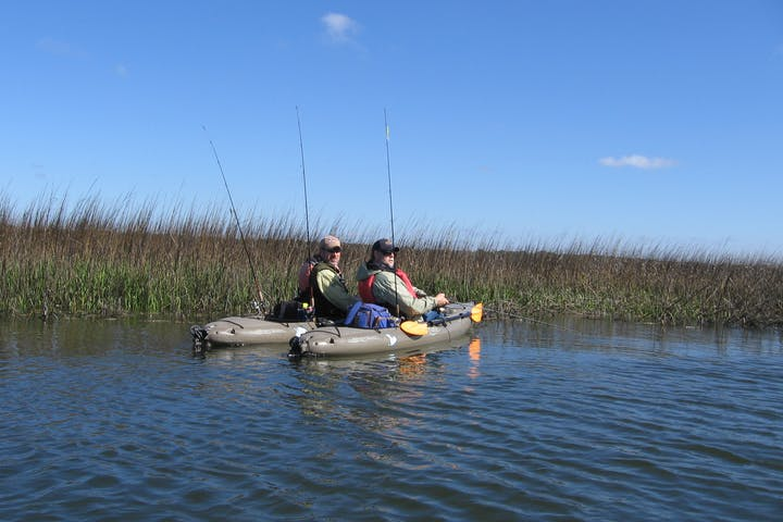 2 people on Hobie fishing kayaks
