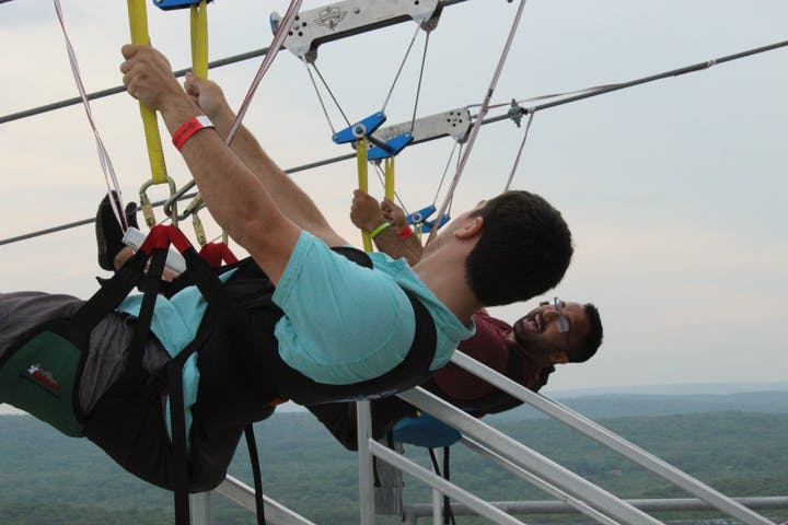 friends ziplining and smiling