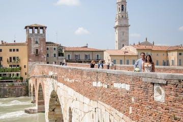 Couple posing on a bridge in Verona