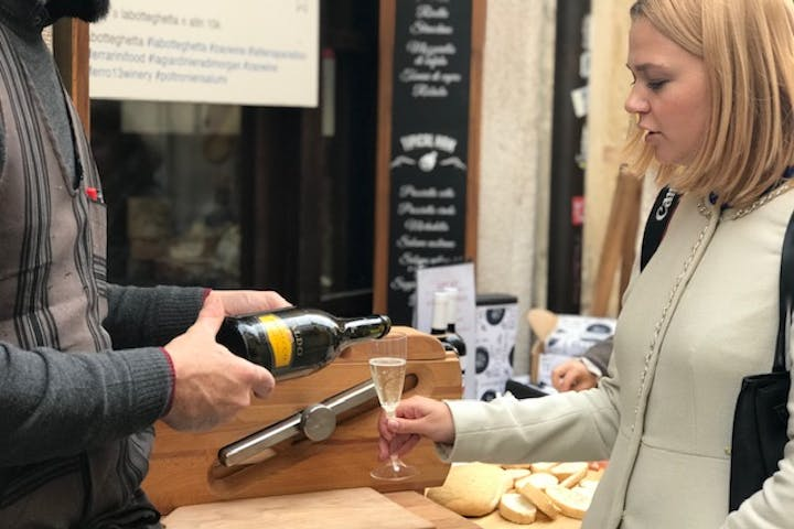 Serving champagne to a customer