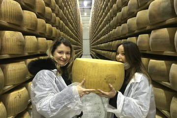 Silvia and Virginia with a big Parmesan cheese