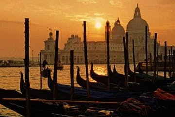 Sunset in Venice, gondolas.