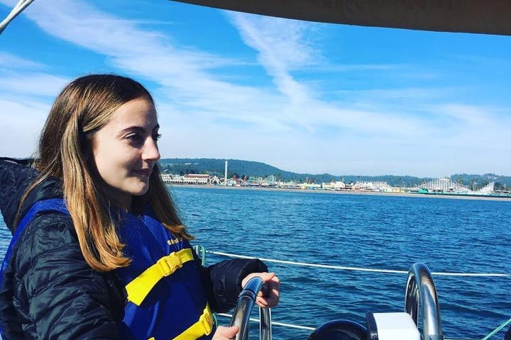 A girl driving a boat