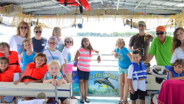 A group enjoys a dolphin cruise with Dolphin Tales