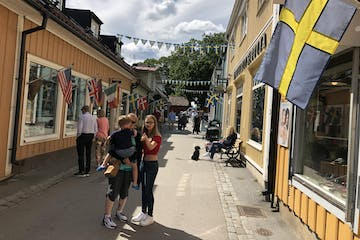wooden houses Swedish flag Sigtuna city Tour from Stockholm