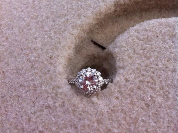 a wedding ring in the sand