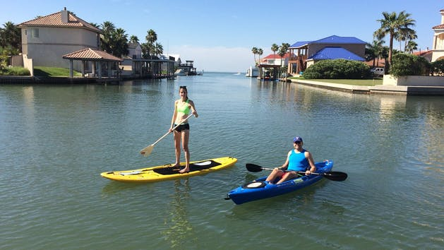 Stand up paddle boarding and kayaking with Parrot Eyes Watersports