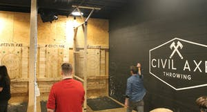 men competing at Civil Axe Throwing