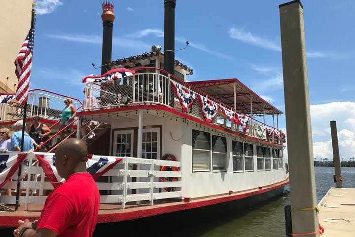riverboat at the dock with people walking down stairs