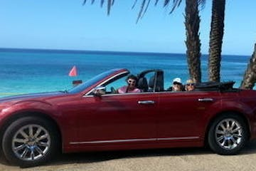 Red convertible on beach