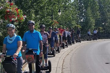 Large group riding on sidewalk with segways