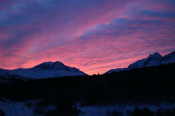 Pink and purple sunset with mountains