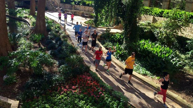 Running along the San Antonio River Walk