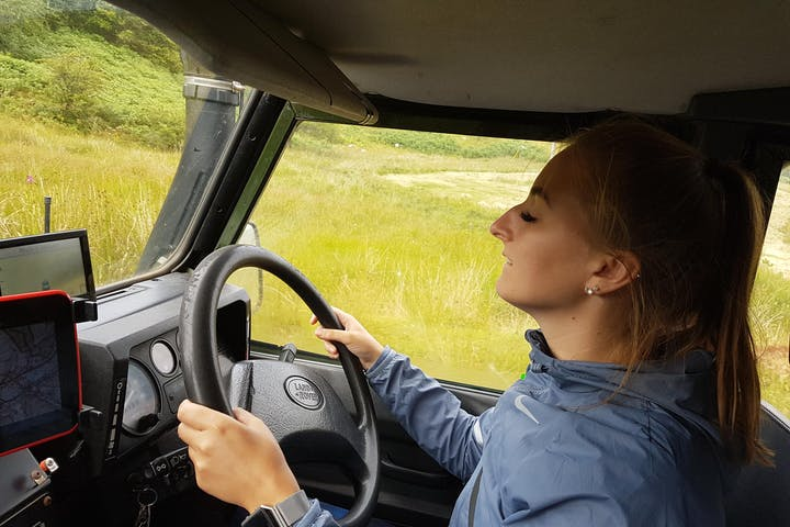 Lady driving Land Rover Defender