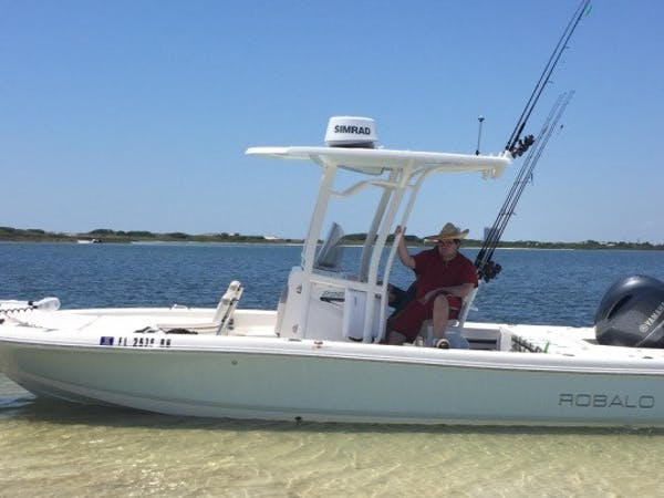 Robalo fishing boat anchored off island in Destin