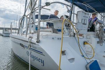 Three crew members on the Odyssey yacht
