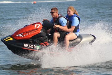 A couple riding a jet ski during their 1 hour rental
