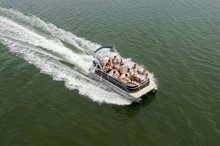 A group riding in a pontoon boat