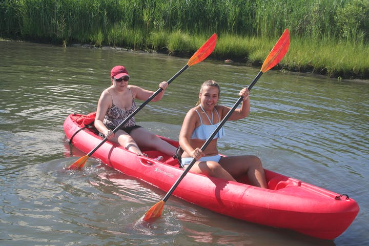 A couple in a tandem kayak