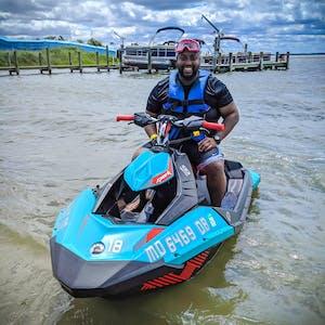 a man sitting on a jetski at Odyssea Watersports