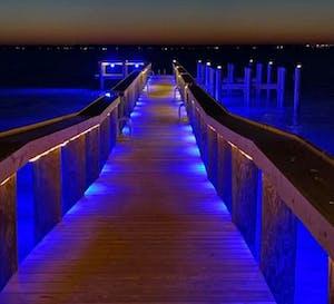 a pier that has blue lights