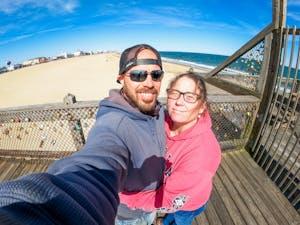 a couple enjoying the fishing pier overlooking the Maryland coast line
