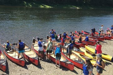 Group next to canoes