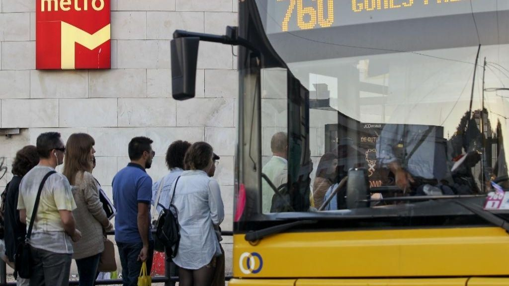a group of people standing around a bus