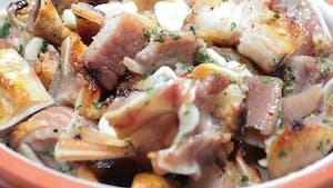 a plate of a Portuguese petisco made of pork ear.