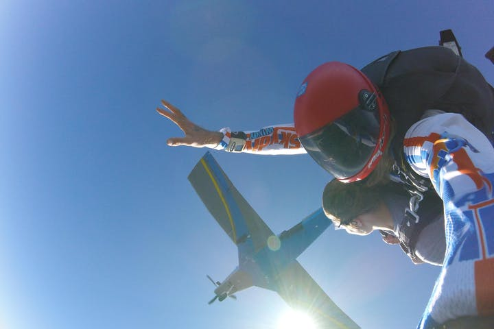 tandem skydive with plane overhead