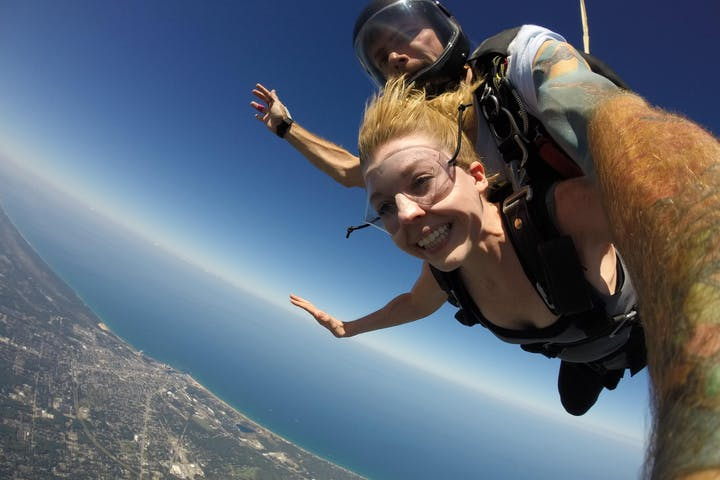 man and woman skydiving over chicago