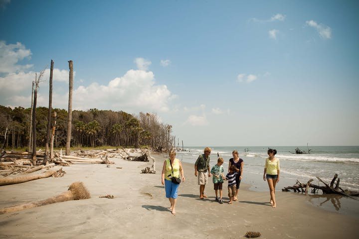 family walking on beach in South Carolina