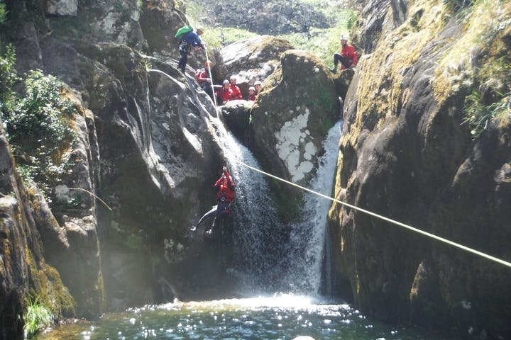 Group of people doing canoying