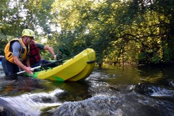 Men descending a river with canoe
