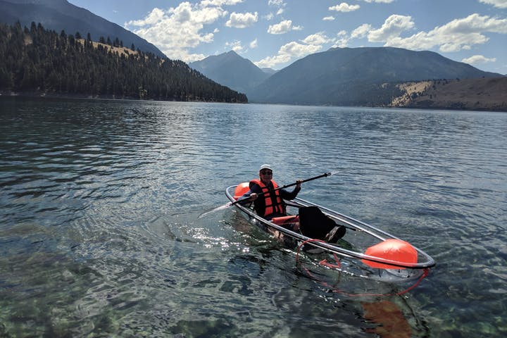 Person in a clear kayak in water