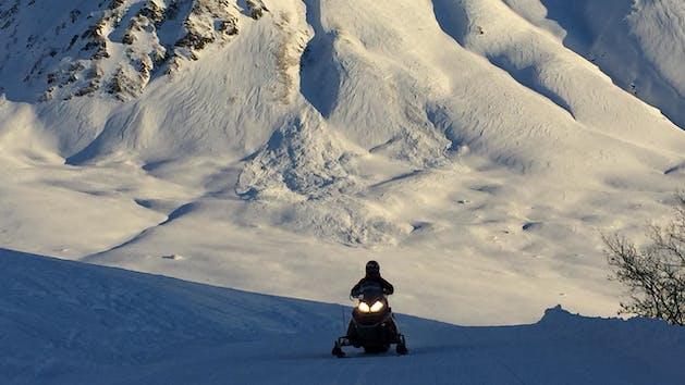 Snowmobile on scenic trails in Alaska
