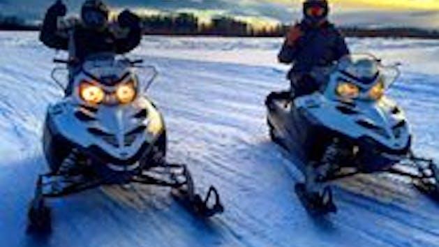 Explore Alaska via Snowmobile