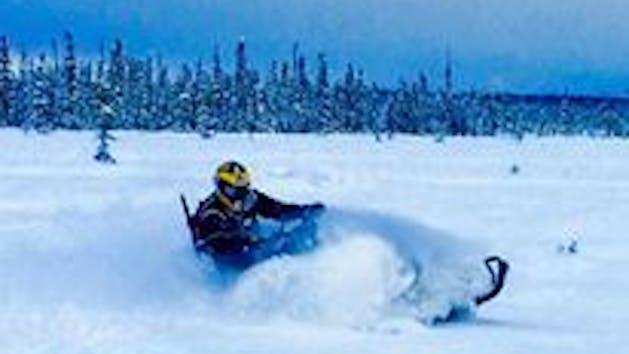 Snowmobile Alaska's fresh powder