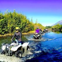 Cruising through water on an Alaska ATV tour